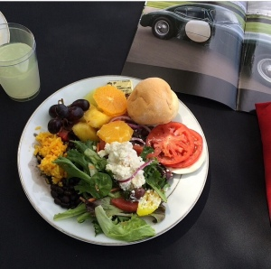 While at a car show, I got to eat a delicious salad with fruit on the side.